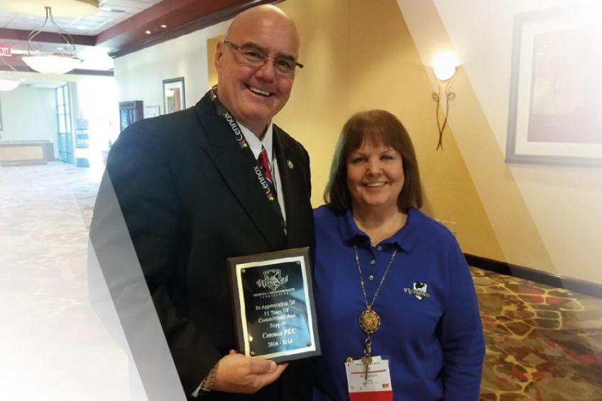 A picture of Cennox accepts FSPA 15-year membership award