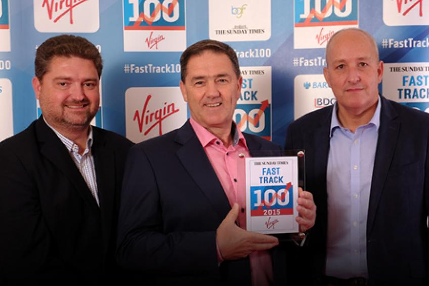A picture of Cennox win the award for 'Best Management Team' at the FastTrack 100 awards evening